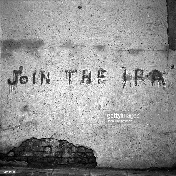 A spray painted message on a wall in Belfast reading 'Join The IRA' Original Publication Picture Post 7029 The Best And The Worst Of Some British...