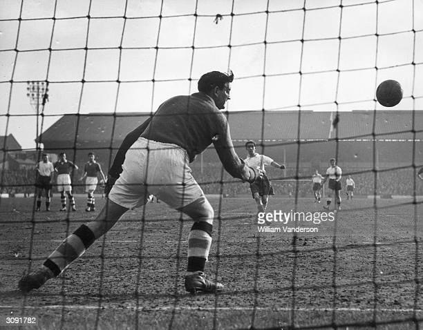 Chelsea goalkeeper Robertson is unable to save a penalty kick from Tottenham Hotspur inside right Tommy Harmer during a league match at Spurs' White...