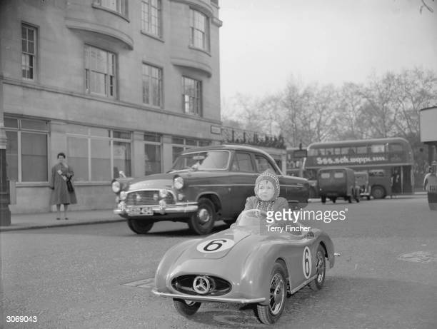 Threeyearold Debbie Browne of Pittsburgh arrives at the Toy Fair held in Park Lane House London in a 12volt batterypowered Mercedes toy car priced at...