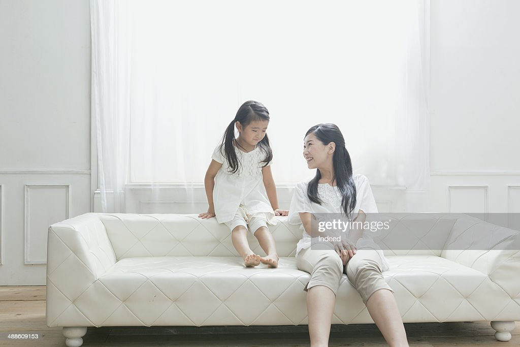 20th generation mother and a 6 year old girl who sit together : Stock Photo