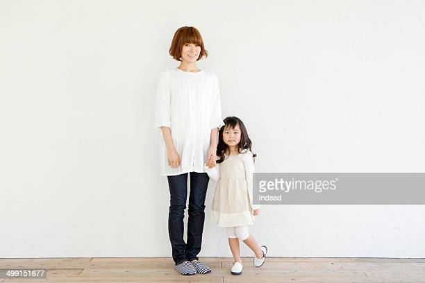 20th generation woman standing with her daughter