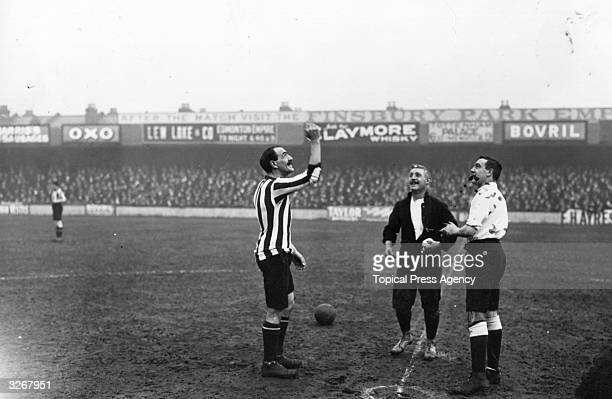 Dan Steel the Tottenham Hotspur captain watches as the Sunderland captain tosses up before the kick off of a match
