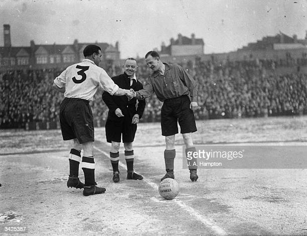The captains of a Football Association XI and an Army XI shake hands before a game at Selhurst Park in London Arsenal player Eddie Hapgood led the...