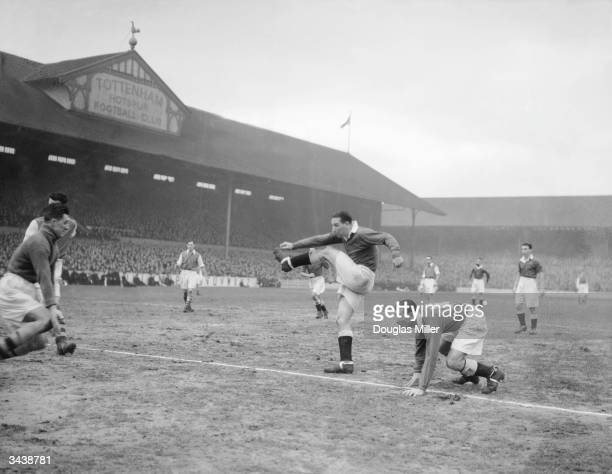 Chelsea centreforward Tommy Lawton scores his second goal during the second replay of the FA cup tie between Arsenal and Chelsea at the Tottenham...