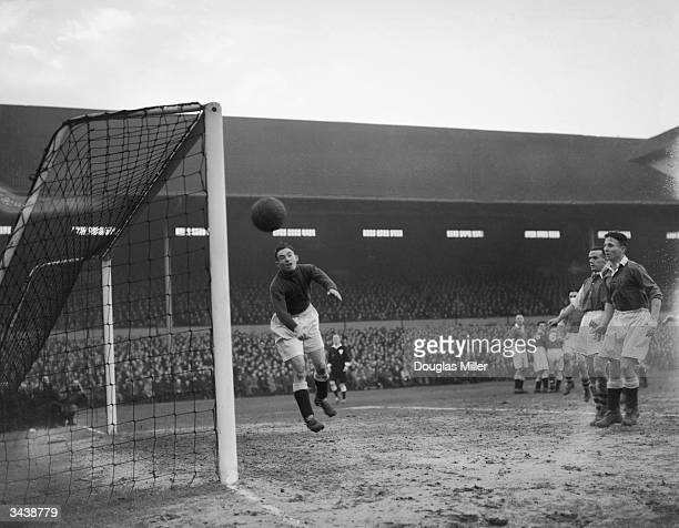 Chelsea goalkeeper Medhurst makes a brilliant save from a free kick during the second replay of the FA cup tie between Arsenal and Chelsea at the...