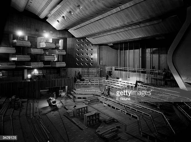The interior of the Royal Festival Hall on London's South Bank nears completion lacking only furnishings and decoration The Hall is being constructed...