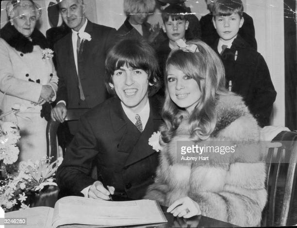 Beatles George Harrison signing the register during his wedding to Patti Boyd