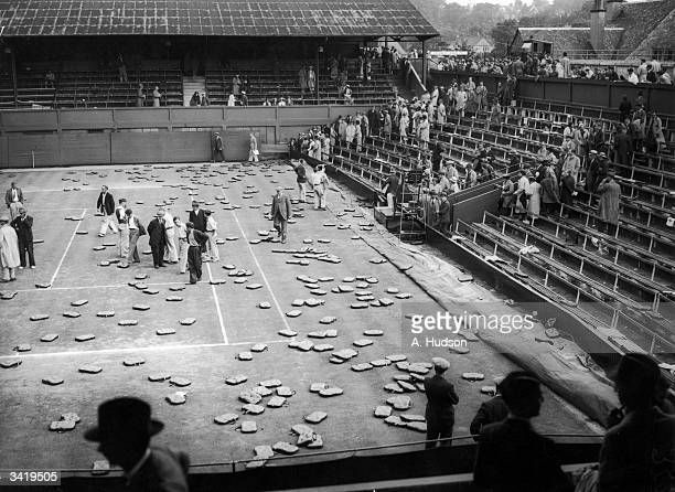 Cushions strewn across the Centre Court at Wimbledon after being thrown by angry crowds when rain stopped play during the interzone Davis Cup final...