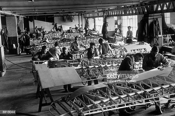 Factory workers assembling the wing elements of Hawker Hurricane aeroplanes