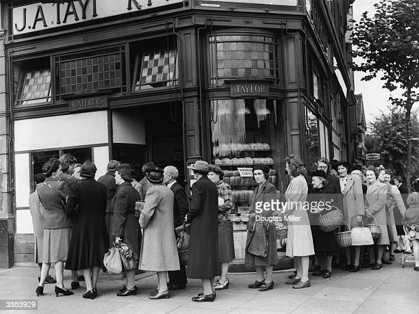 Queues forming outside a bakery in Streatham High Street London on the last day before bread rationing is introduced