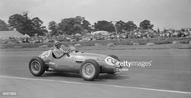 Argentinian motor racing legend Juan Manuel Fangio in a BRM motor during the Grand Prix race at Silverstone.