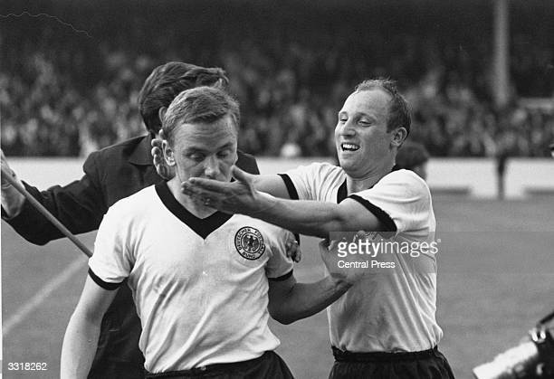 German footballer Uwe Seeler rushes to embrace teammate Werner Kramer after victory over Spain in a World Cup match at Villa Park Birmingham Seeler...