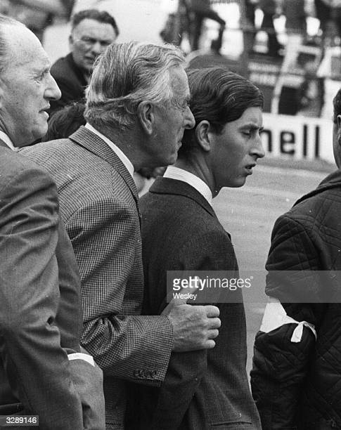Earl Louis Mountbatten and Prince Charles watching the RAC Grand Prix at Brands Hatch