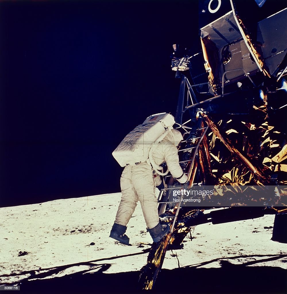 American astronaut Edwin 'Buzz' Aldrin Jnr steps onto the lunar surface from the Apollo 11 lunar module to become the second man to walk on the moon.