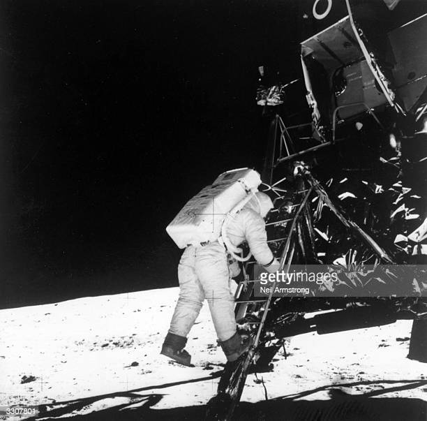 American astronaut Edwin 'Buzz' Aldrin Jnr steps onto the lunar surface from the Apollo 11 lunar module to become the second man to walk on the moon