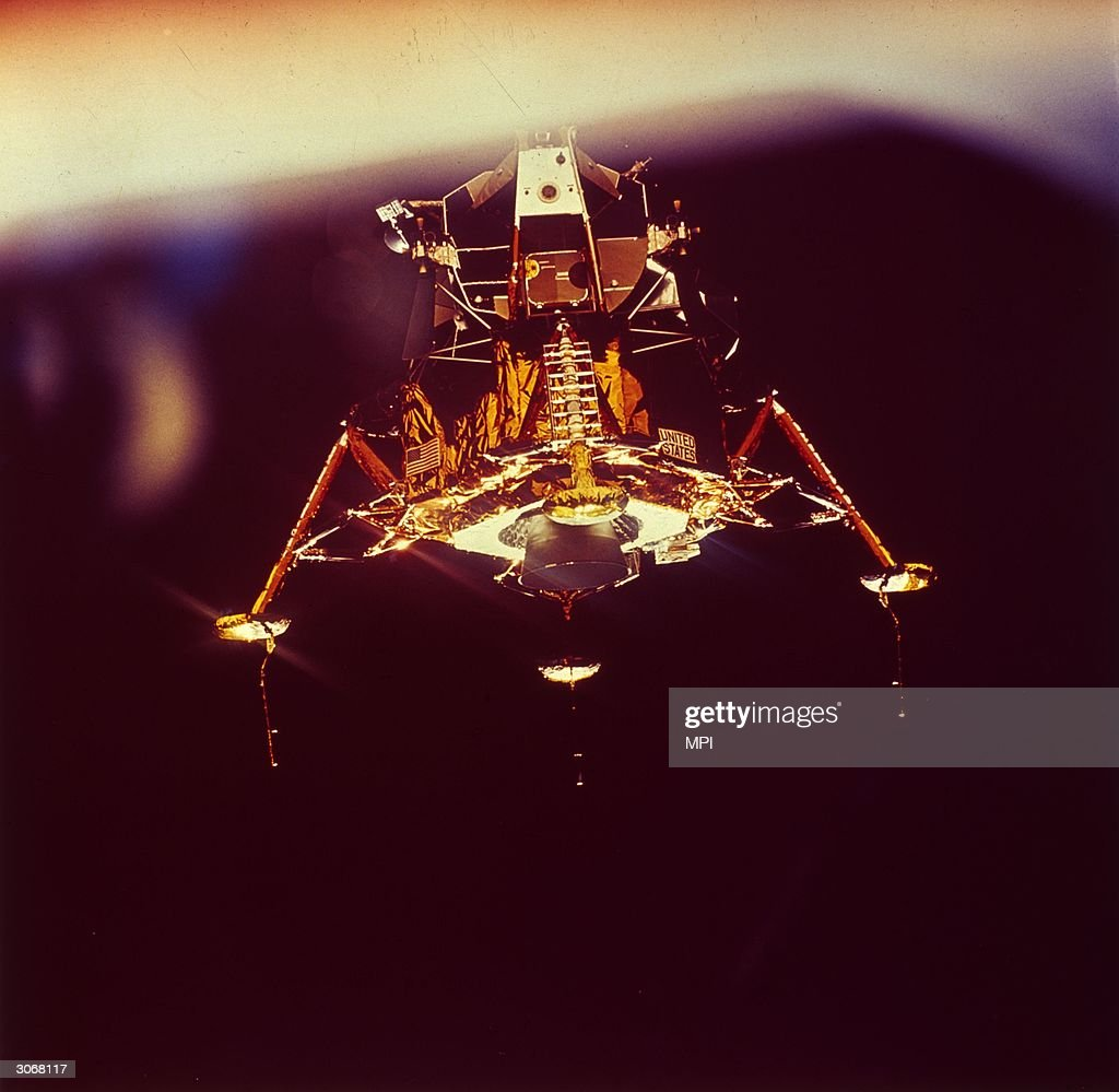 The lunar landing module Eagle descends onto the surface of the moon, carrying Apollo 11 astronauts Edwin 'Buzz' Aldrin and Neil Armstrong. Fellow-astronaut Michael Collins remains in the command module Columbia.
