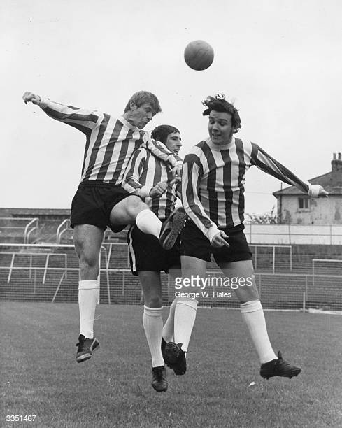 Brentford Football Club's new signings Mike Maskel Jackie Graham and Paul Bence display their skills