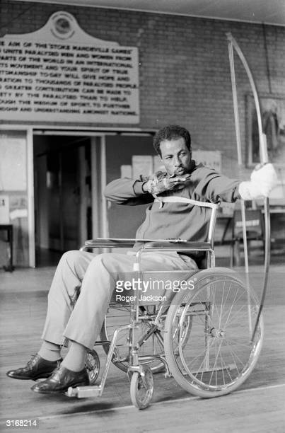 Former marathon runner and winner of two Olympic gold medals Abebe Bikila practises archery from his wheelchair in preparation for the International...