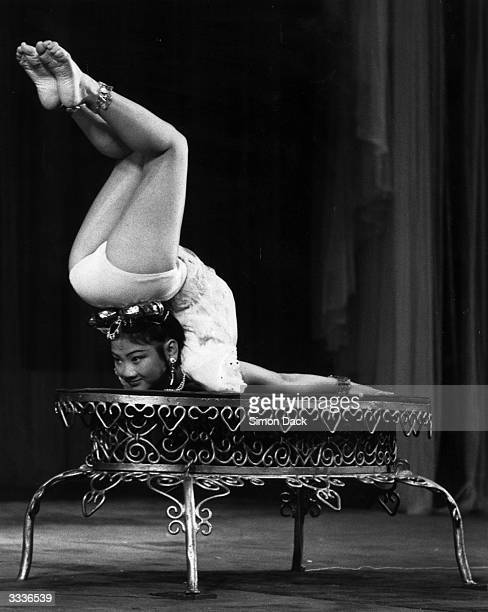 12yearold Liu Ho of the Chinese Acrobats from Chungking performs a spectacular contortion as part of her act at the Dominion Theatre London