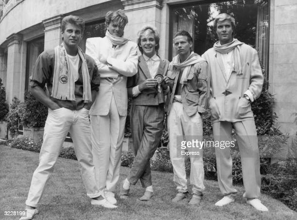 Portrait of British pop group Duran Duran standing outdoors Left to right drummer Roger Taylor guitarist John Taylor keyboard player Nick Rhodes...