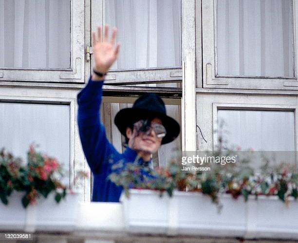 Michael Jackson appears on a balcony at the Hotel D'Angleterre in Copenhagen Denmark on 20th July 1992