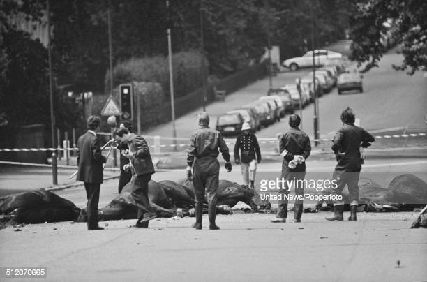 View of the aftermath of the Hyde Park bombing with dead horses from the Blues Royals cavalry regiment lying on South Carriage Drive following the...