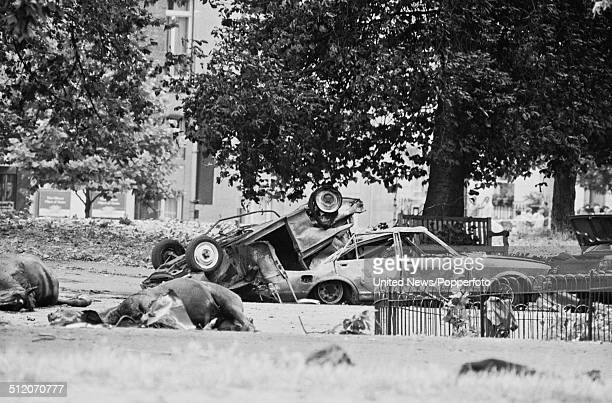 View of the aftermath of the Hyde Park bombing with dead horses from the Blues Royals cavalry regiment and wrecked cars on South Carriage Drive after...