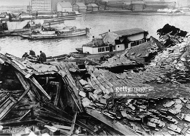 Houses and warehouses by the harbour in Toyooka Japan destroyed by earthquake and fire