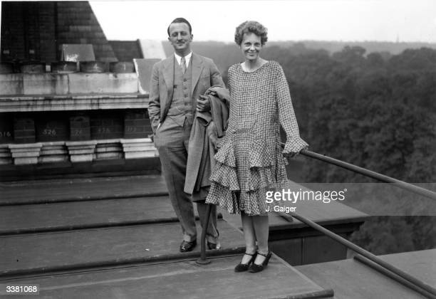 American aviator Amelia Earhart on the roof of the Hyde Park Hotel in London with Captain Railey