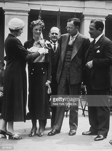 American aviator Amelia Earhart is awarded the Cross of Honor from the United States Flag Association, New York City. Her husband, George Palmer...