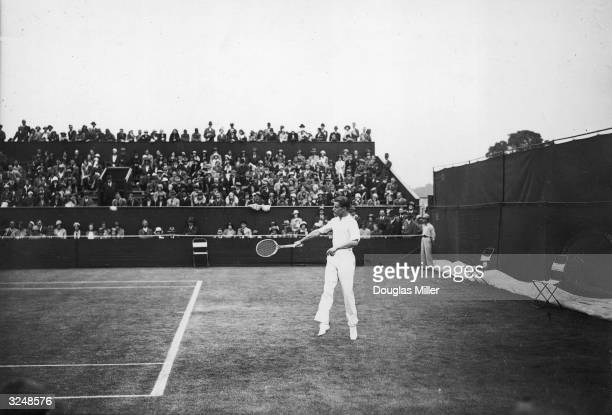 H W 'Bunny' Austin in winning form against M A Young during the Lawn Tennis Championships at Wimbledon