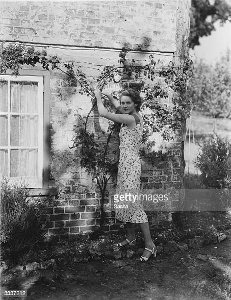 English film actress Ann Todd doing some gardening at home at Black Jack Cottage Harefield Ruislip Middlesex