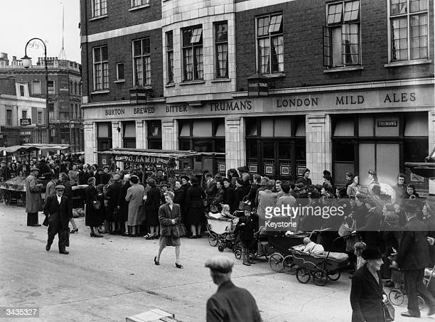 Housewives queuing for potatoes in Westmoreland Road Camberwell London