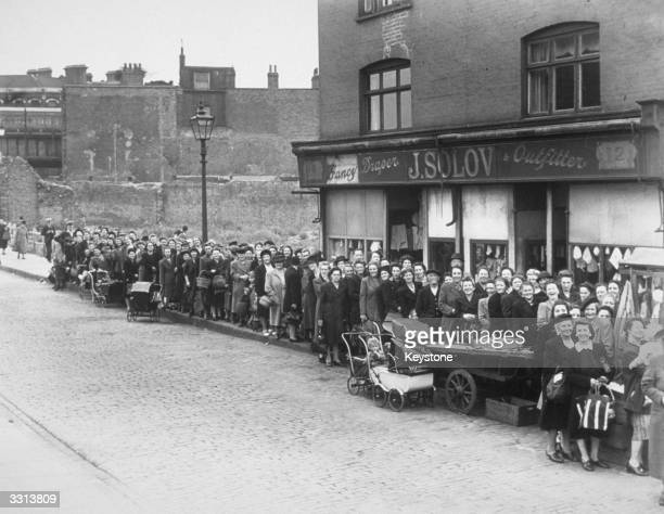 The potato shortage hits London forcing women in Camberwell south London to queue for the small supply of potatoes available