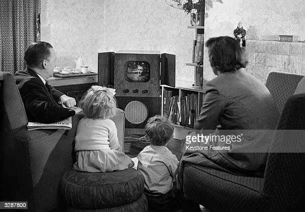 A family watching television at home