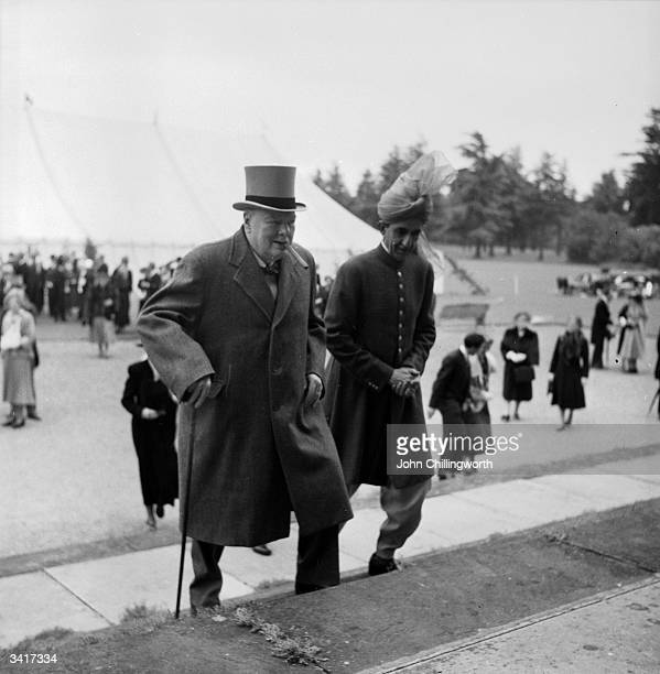British Prime Minister Winston Churchill with the Sultan of Kelantan Malaysia at a garden party at Blenheim Palace in Oxfordshire to celebrate the...