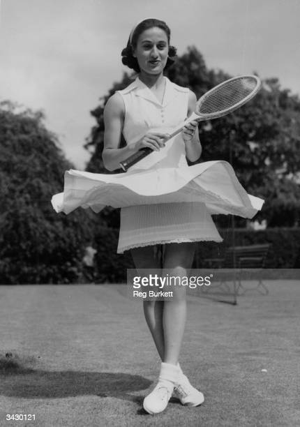 Dorothy Levine of the USA showing off her four nylon petticoats under her tennis dress at a Hurlingham Club 'gettogether' prior to Wimbledon
