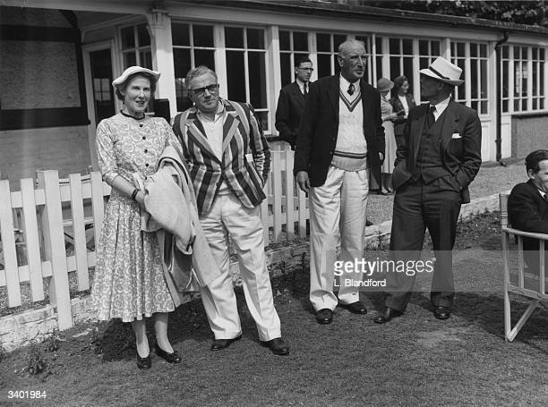 To R Mrs Don Smith, Sydney Goldsack , D R Jardine ) and Mr Don Smith seen at cricket match between Authors and the National Book League.The match is...