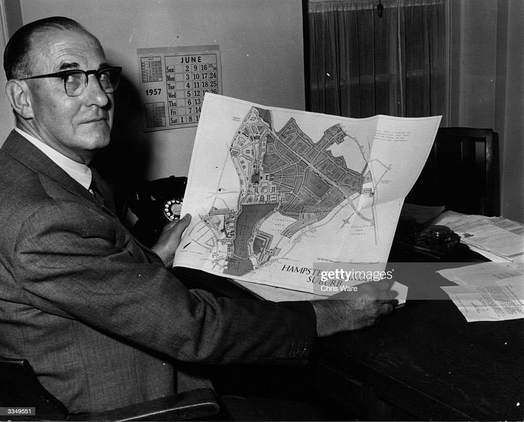 The secretary of the Hampstead Garden Suburb Trust with a map of the area, the first planned suburb in Britain.