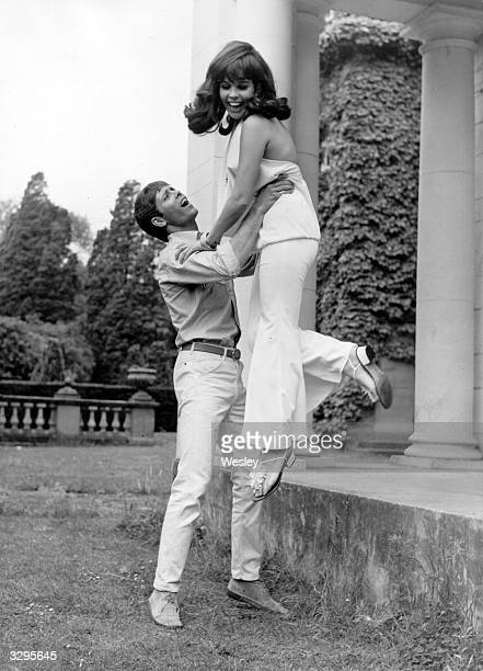 British pop singer and actor Cliff Richard has some fun with Vivienne Ventura during a break in shooting his new film 'Finders Keepers' at Pinewood...