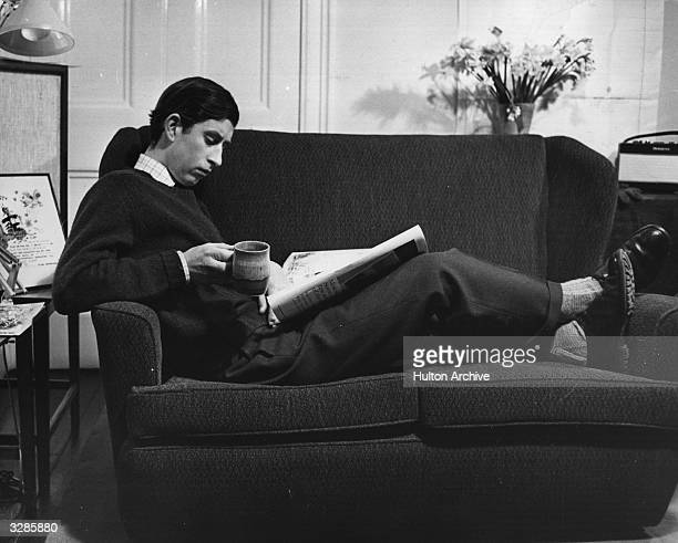 Charles Prince of Wales relaxing in his study at Cambridge University