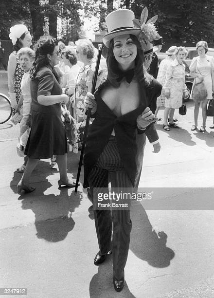 Erotic actress Linda Lovelace wears a top hat and tails with pinstripe trousers to the third day of Royal Ascot