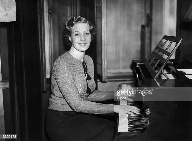 British actress Binnie Barnes at the piano She is going to Hollywood to star in two pictures for Universal Films 'Diamond Jim' and 'Delay in the Sun'