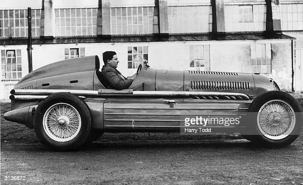 British racing driver Austin Dobson in the 240 mph twin engined Alfa Romeo car in which he hopes to beat the world record of 24615 mph at Brooklands