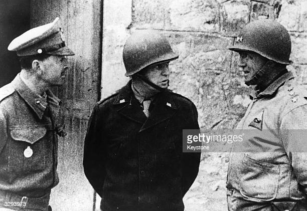 General Dwight D Eisenhower , Allied Commander-in-Chief, with General Harold Alexander , Deputy Commander, and Lieutenant General George Patton in...