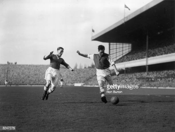 Denis Compton , right, playing for Arsenal reserves against Chelsea at Highbury in north London.