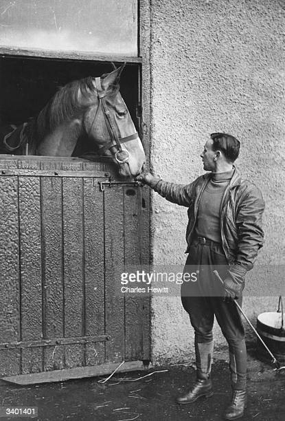 Jockey Raymond Cane at a stables with racehorse Turning Point Original Publication Picture Post 4525 What It Means To Be A Steeplechase Jockey pub...