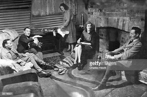 Jump jockey Raymond Cane second jockey for Jack Fawcus's stable in Yorkshire lives in a Nissen hut near the stables where he works Mrs Cane is...