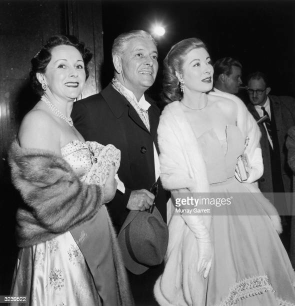 EXCLUSIVE Married actors Benita Hume and Ronald Colman smile while posing with actor Greer Garson at the Academy Awards RKO Pantages Theater Los...