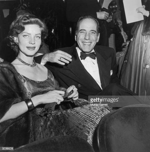 EXCLUSIVE Married American actors Lauren Bacall and Humphrey Bogart smile while seated in formal evening wear at the Academy Awards RKO Pantages...